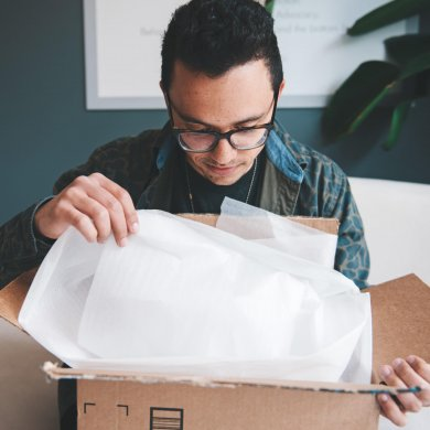 Man opening a package